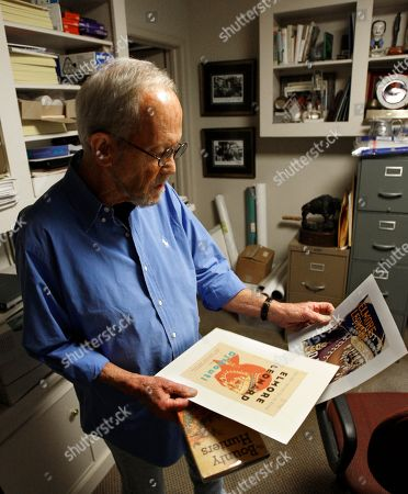 """Elmore Leonard Author Elmore Leonard shows off variations of the book cover to his newest novel """"Djibouti"""" at his home in Bloomfield Township, Mich., . Leonard's 44th novel, """"Djibouti,"""" hit shelves on Tuesday, a day after he celebrated his 85th birthday"""