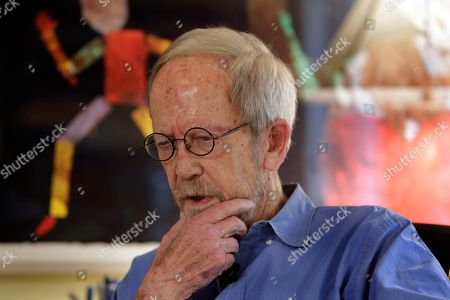 """Elmore Leonard Author Elmore Leonard is interviewed at his home in Bloomfield Township, Mich., . He's two decades past the age when most Americans begin receiving Social Security benefits. And the Hot Kid's never been hotter. Leonard's 44th novel, """"Djibouti,"""" hit shelves on Tuesday, a day after he celebrated his 85th birthday"""