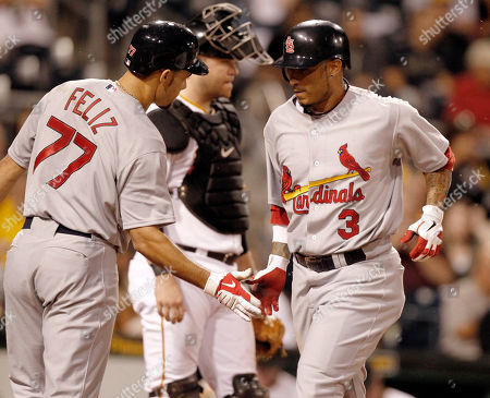 Felipe Lopez St. Louis Cardinals' Felipe Lopez, right, is greeted by teammate Pedro Feliz, left, after hitting a solo home run in the seventh inning of the baseball game against the Pittsburgh Pirates in Pittsburgh, . Pirates catcher Chris Snyder, center, looks on