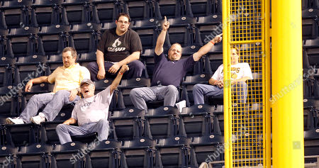 Pittsburgh Pirates fans point towards foul as Pirates manager John Russell talks with umpires about whether a home run by St. Louis Cardinals' Felipe Lopez was a fair ball ijn the seventh inning of the baseball game in Pittsburgh, . The home run call stood