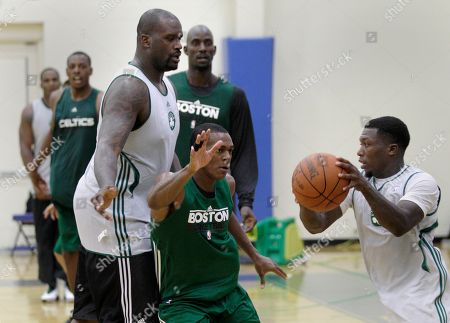 Shaquille O'Neal, Rajon Rondo, Nate Robinson, Kevin Garnett, Paul Pierce Boston Celtics center Shaquille O'Neal, left, sets a pick as guard Nate Robinson, right, tries to get past guard Rajon Rondo during their practice at the team's training camp at Salve Regina University in Newport, R.I., . At rear left is forward Paul Pierce, and at rear center is forward Kevin Garnett