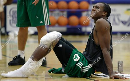 Rajon Rondo Boston Celtics guard Rajon Rondo smiles as he rests on the court with his knees iced after their practice at the team's training camp at Salve Regina University in Newport, R.I