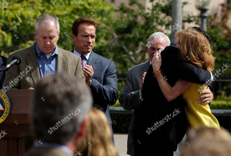 Arnold Schwarzenegger, Brent king, Kelly King Chelsea King's mother Kelly King, right, joined by her husband Brent, left, and Gov. Arnold Schwarzenegger second from left, is comforted by Assemblyman Nathan Fletcher, R-San Diego, in San Diego, Calif., . Gov. Schwarzenegger signed Chelsea's Law, named for 17-year-old Chelsea King, who was murdered in San Diego in February. A convicted child molester was sentenced to life in prison without parole less than three months later for killing King and 14-year-old Amber Dubois
