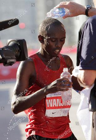 Stock Image of Sammy Wanjiru Sammy Wanjiru, of Kenya, cools off after he won the Chicago Marathon, in Chicago