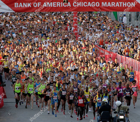 Stock Picture of Thousands of runners participate in the Chicago Marathon ib in Chicago. Sammy Wanjiru, of Kenya, won the men's division, and Liliya Shobukhova, of Russia, won the women's