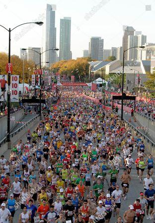Runners take part in the Chicago Marathon, in Chicago. Sammy Wanjiru, of Kenya, was the men's winner, and Liliya Shobukhova, Russia, was the women's