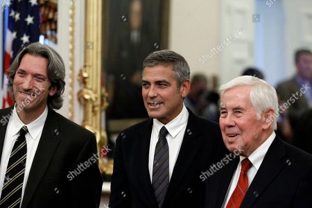 Richard Lugar, George Clooney, John Prendergast Author and activist John Prendergast, left, and actor George Clooney, talk with Chairman of the Senate Foreign Relations Committee Ranking Member, Sen. Richard Lugar, R-Ind., before their meeting about the situation in Sudan, on Capitol Hill in Washington