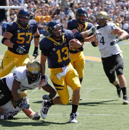 Kevin Riley, Anthony Perkins California quarterback Kevin Riley (13) breaks the attempted tackle by Colorado's Anthony Perkins (46) during the first half of an NCAA college football game, in Berkeley, Calif