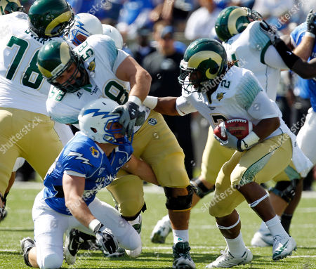 Stock Photo of Patrick Hennessey, Jake Gdowski, Leondard Mason Air Force linebacker Patrick Hennessey, left, is blocked by Colorado State offensive linesman Jake Gdowski (58) as Colorado State running back Leonard Mason (2) runs the ball during the first half of a NCAA college football game at the Air Force Academy, Colo., on