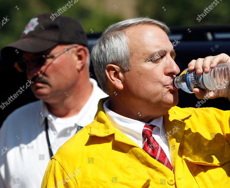 Bill Ritter, Joe Pelle Colorado Gov. Bill Ritter, right, takes a drink of water after touring a wildfire west of Boulder, Colo., with Sheriff Joe Pelle, left, on . Ritter says a Type One team is coming in to help fight the wildfire that has destroyed a dozen or more home since it started Monday