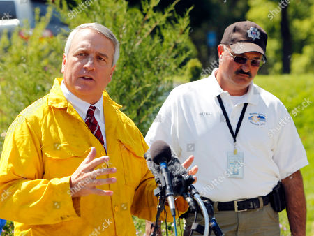 Bill Ritter, Joe Pelle Colorado Gov. Bill Ritter, left, talks about a a wildfire west of Boulder, Colo., after touring the area with Sheriff Joe Pelle, right, on . Ritter says a Type One team is coming in to help fight the wildfire that has destroyed a dozen or more home since it started Monday