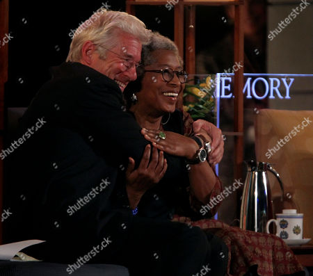 Richard Gere, Alice Walker Actor Richard Gere, left, embraces author Alice Walker, during a lecture series with The Dalai Lama at Emory University, in Atlanta