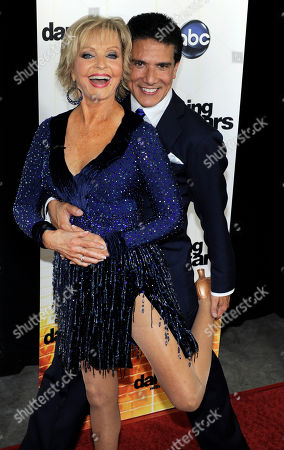 "Florence Henderson, Corky Ballas Contestant Florence Henderson poses with her dance partner Corky Ballas at the 11th season premiere of ""Dancing with the Stars"