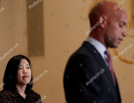 Michelle A. Rhee, Adrian M. Fenty DC Schools Chancellor Michelle Rhee listens at left, during the announcement that she is resigning, during a news conference with Washington Mayor Adrian Fenty, right, in Washington