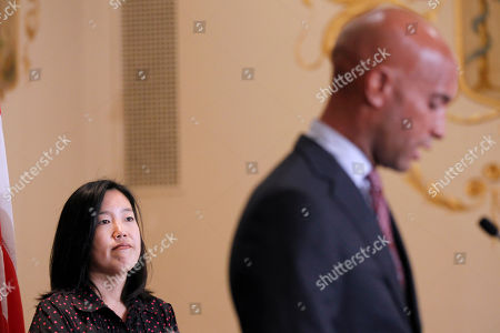 Michelle Rhee, Adrian Fenty DC Schools Chancellor Michelle Rhee listens at left, during the announcement that she is resigning, during a news conference with Washington Mayor Adrian Fenty, right, in Washington