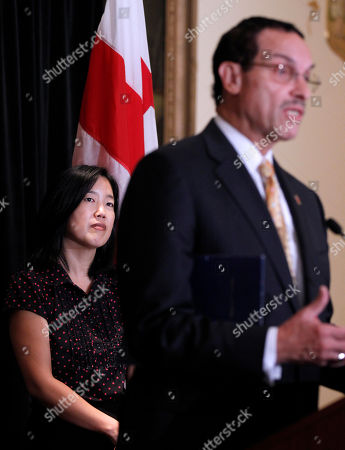 Michelle Rhee, Vincent Gray DC Schools Chancellor Michelle Rhee looks on at left, as DC City Council chairman and Democratic Mayoral candidate Vincent Gray, speaks during a news conference in Washington, to announcement that she is resigning