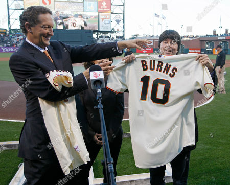 Ken Burns, Larry Baer San Francisco Giants chief operating officer Larry Baer, left, presents a Giants jersey to filmmaker Ken Burns, right, before a baseball game against the Los Angeles Dodgers in San Francisco