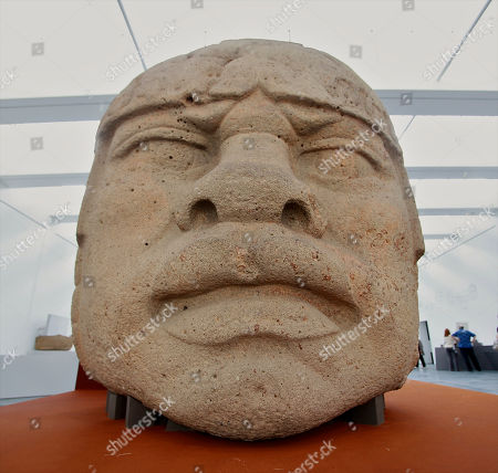 """On, a basalt Olmec Colossal Head 5, from the 1200-1900 BC period weighing 7170 lb. is part of The """"Olmec: Colossal Masterworks of Ancient Mexico,"""" installation on view at the newly inaugurated Lynda and Stewart Resnick Exhibition Pavilion at the Los Angeles County Museum of Art"""