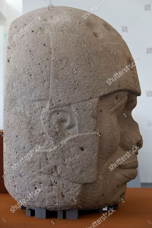 """On, A colossal Olmec head made of basalt is seen from profile is part of The """"Olmec: Colossal Masterworks of Ancient Mexico,"""" installation is on view at the newly inaugurated Lynda and Stewart Resnick Exhibition Pavilion at the Los Angeles County Museum of Art"""