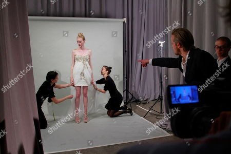 Edward Chapman, second from right, CEO of Marchesa, coordinates a photo shoot of a model for the presentation of the Marchesa Spring 2011 collection, during Fashion Week in New York