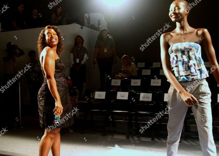 Stock Photo of Fashion designer Tracy Reese, left, directs model Ataui Deng on her runway walk before presenting her Spring 2011 collection, during Fashion Week in New York