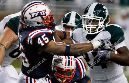 Le'Veon Bell, Michael Lockley Michigan State running back Le'Veon Bell (24) stiff arms Florida Atlantic linebacker Michael Lockley (45) enroute to a touchdown during the first quarter of a college football game at Ford Field in Detroit