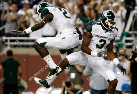Le'Veon Bell, Michael Lockley Michigan State receiver B.J. Cunningham (3) celebrates his second quarter touchdown with teammate Mark Dell (2) during a college football game against Florida Atlantic at Ford Field in Detroit