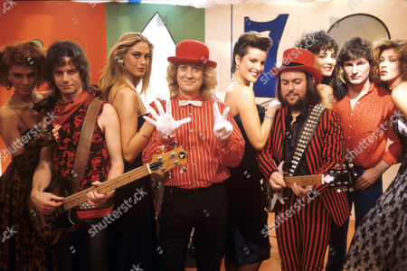 Stock Photo of Slade - Jim Lea, Noddy Holder, Dave Hill, Don Powell and models
