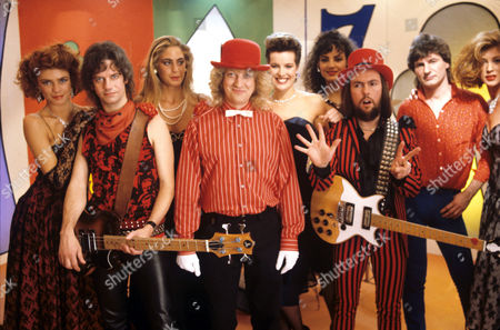 Slade - Jim Lea, Noddy Holder, Dave Hill, Don Powell and models