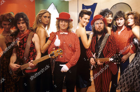 Stock Image of Slade - Jim Lea, Noddy Holder, Dave Hill, Don Powell and models