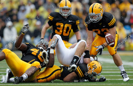Keith Wenning, Christian Ballard, Brett Greenwood, Micah Hyde, Jeff Tarpinian Ball State quarterback Keith Wenning, center, fumbles the ball between Iowa defenders Christian Ballard, left, Micah Hyde (18), Brett Greenwood (30) and Jeff Tarpinian (33) during the first half of an NCAA college football game in Iowa City, Iowa. Iowa's defense is rounding into form as Big Ten play opens this weekend when they host Penn State. The 17th-ranked Hawkeyes lead the nation in total defense after holding Ball State to just 112 yards last Saturday