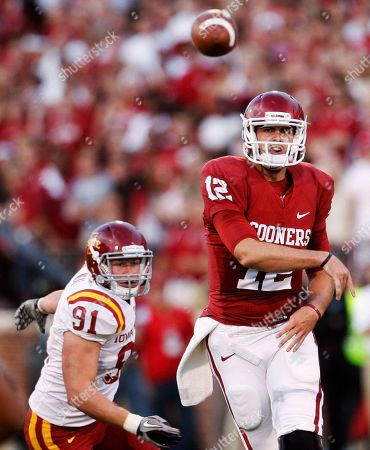 Landry Jones, Patrick Neal Oklahoma quarterback Landry Jones, right, and Iowa State Patrick Neal, left, watch his pass in the first quarter of an NCAA college football game in Norman, Okla., . Oklahoma won 52-0