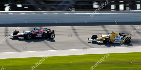 Ryan Briscoe, Sarah Fisher Ryan Briscoe, Sydney, Australia, leads Sarah Fisher (66) through a turn during practice for the PEAK Antifreeze and Motor Oil Indy 300 auto race at Chicagoland Speedway in Joliet, Ill