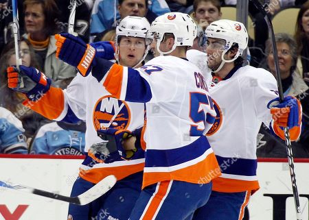 Blake Comeau, Doug Weight, Josh Bailey New York Islanders' Josh Bailey, left, celebrates with teammates Blake Comeau, center, and Doug Weight, right, after scoring a goal in the second period of an NHL hockey game against the Pittsburgh Penguins in Pittsburgh, . The Penguins won in overtime 3-2