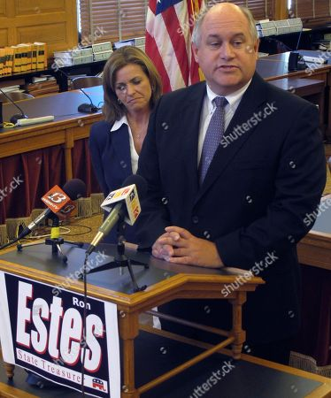 In this photo from, Ron Estes, the Republican candidate for Kansas state treasurer, discusses his campaign during a news conference at the Statehouse in Topeka, Kan. Beside him is U.S. Rep. Lynn Jenkins, a Republican who was treasurer in 2003-08