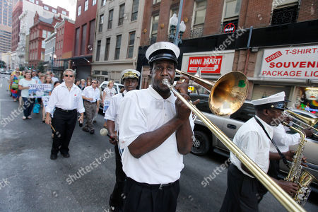 A brass band plays as singer Charmaine Neville, actress Shauna Rappold (both not pictured), and others hold a symbolic jazz funeral for victims of Hurricane Katrina, as the fifth anniversary of the storms in downtown New Orleans