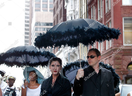 Charmaine Neville, Shauna Rappold Singer Charmaine Neville, background left, and actress Shauna Rappold, center, playing the role of a grieving woman, participate in a symbolic jazz funeral to honor Hurricane Katrina victims, ahead of the fifth anniversary of the storm, in downtown New Orleans