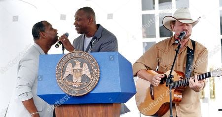 """Melvin Williams, Doug Williams, Paul Overstreet Country music singer Paul Overstreet, right and gospel singers Melvin Williams, left, and Doug Williams, center of the William Brothers, sing during the """"Mississippi Gulf Coast Five Years Forward, A Celebration of Katrina Recovery,"""" program in Gulfport, Miss"""