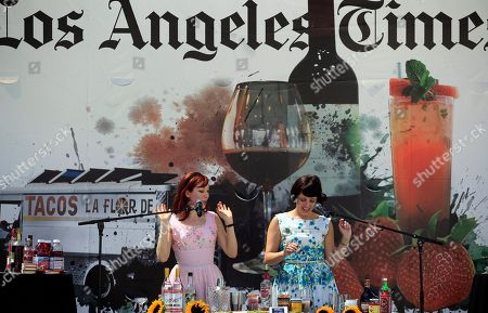 "Alie Ward, left with Georgia Hardstark, from an online web site dedicated to food and drink, called ""Drinks with Alie & Georgia"" demontrate mixing cocktails, at the Los Angeles Times Celebration of Food and Wine, at Paramount Pictures Studios in the Hollywood section of Los Angeles on"