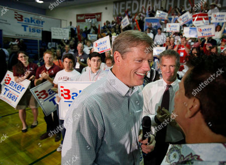Stock Image of Charles Baker, Scott Brown, Lenny Clarke Republican candidate for Massachusetts Governor Charles Baker with comedian Lenny Clarke, right, and U.S. Sen. Scott Brown, R-MA., center, during a campaign rally at Needham High School in Needham