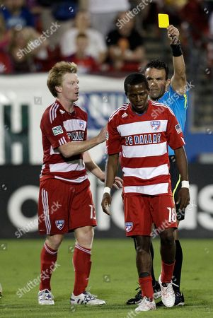 Stock Photo of Hilario Grajeda, Dax McCarty, Marvin Chavez FC Dallas' Dax McCarty, left, Marvin Chavez (18) and referee Hilario Grajeda, rear, during an MLS soccer match against the New York Red Bulls in Frisco, Texas
