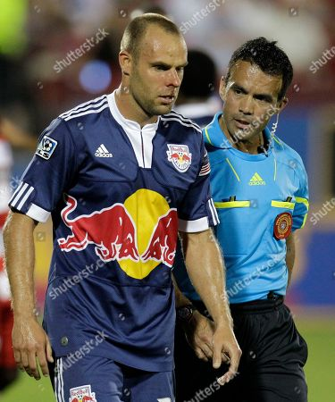 Joel Lindpere, Hilario Grajeda New York Red Bulls midfielder Joel Lindpere (20) is helped off the field by referee Hilario Grajeda, right, after suffering a nose injury in the second half of an MLS soccer match against FC Dallas, in Frisco, Texas. Lindpere scored a goal in the second half that helped his team to a 2-2 tie in the match
