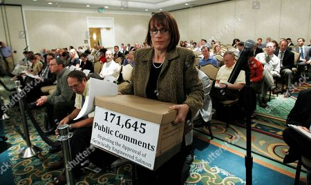 Stock Picture of Wenonah Hauter Wenonah Hauter of Food and Water Watch carries a box containing public comments opposing the Food and Drug Administration (FDA) approval of genetically engineered salmon she is submitting to the committee before she speaks at an FDA veterinary medicine advisory committee hearing on modified salmon in Rockville, Md