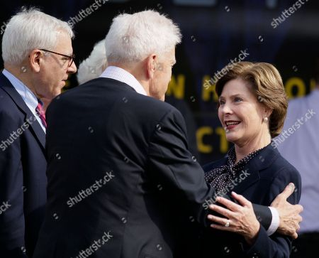 Laura Bush, James H. Billington Former first lady Laura Bush, right, is greeted by Librarian of Congress James H. Billington, second from right as she arrives at the 10th annual National Book Festival, organized and sponsored by the Library of Congress, on the National Mall, in Washington