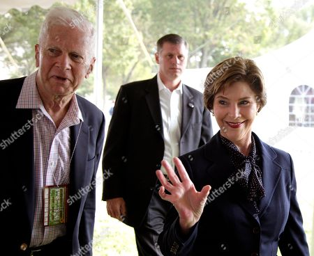 Laura Bush, James H. Billington Former first lady Laura Bush, right, walks with Librarian of Congress James H. Billington, left, as she arrives at the 10th annual National Book Festival, organized and sponsored by the Library of Congress, on the National Mall, in Washington