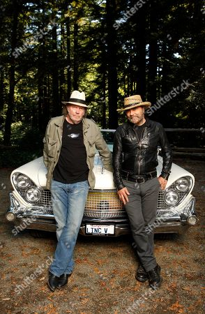 Neil Young, Daniel Lanois Musicians Neil Young, left, and Daniel Lanois are photographed beside Young's 1959 hybrid Lincoln Continental in Woodside, Calif. A fire at a San Francisco Bay area warehouse that stored memorabilia belonging to Neil Young started the vintage car the singer had converted into a hybrid vehicle. Belmont-San Carlos Fire Marshal Jim Palisi told the San Mateo County Times the Nov. 9 fire began in Young's 1959 Lincoln Continental and then spread to the nearby warehouse. Young had converted the car to run on electric batteries and a biodiesel-powered generator as part of the LincVolt project