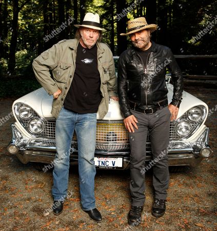 Neil Young, Daniel Lanois Musicians Neil Young, left, and Daniel Lanois are photographed in Woodside, Calif