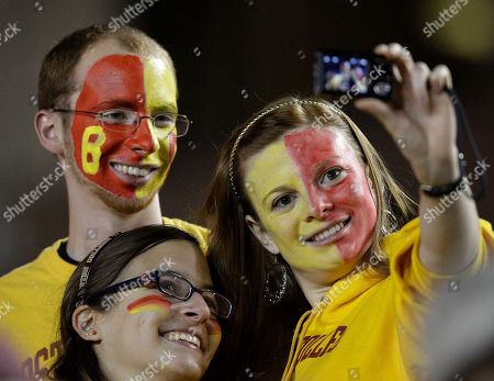 Shelby Garber, Pat Kane, and Brianna Nassif Shelby Garber, 19, right, a Boston College sophomore from Sarasota, Fla., takes a photo of herself with classmates Pat Kane, 19, upper left, from Massapequa, N.Y., and Brianna Nassif, 19, lower left, from Toronto, Canada, before the Boston College NCAA football game against Notre Dame in Boston, Saturday night