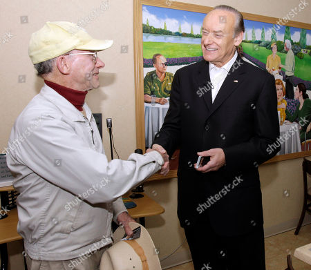 Stock Photo of Lee Fisher, Richard Engel Ohio Democrat Senate candidate Lee Fisher, right, greets resident Richard Engel during a visit to Menorah Park Center for Senior Living in Beachwood, Ohio, . Fisher is running against Republican Rob Portman