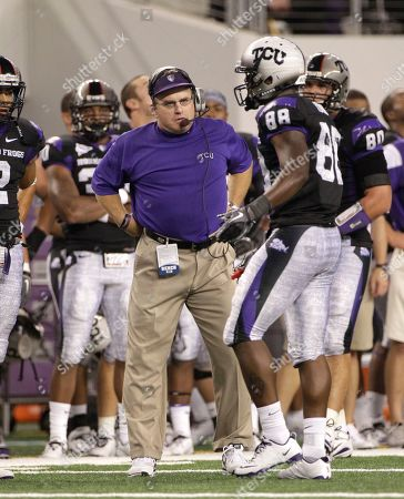 Gary Patterson, Jimmy Young TCU head coach Gary Patterson, center, and wide receiver Jimmy Young (88) during an NCAA college football game against Oregon State, in Arlington, Texas
